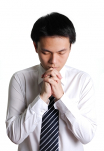 Young Business Man Praying by podpad